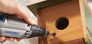 Dremel 3000 vs 4000 comparison of the Dremel 3000 drilling a hole in a birdhouse