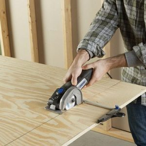 image of dremel ultrasaw cutting plywood