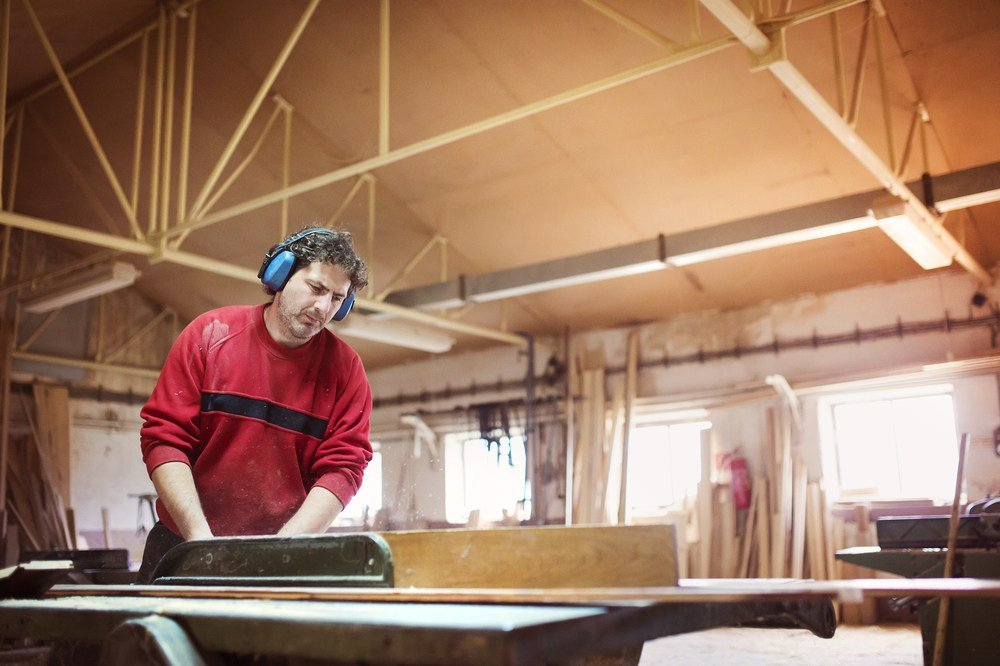 image of a professional cabinetmaker using the best table saw fence