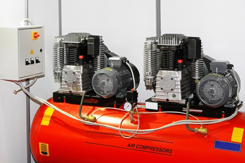 rare double air compressor with two separate compressors feeding into a single tank