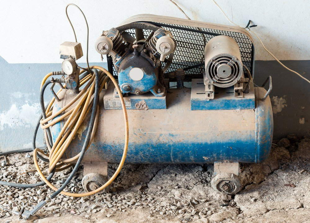 image of compressor covered in dust