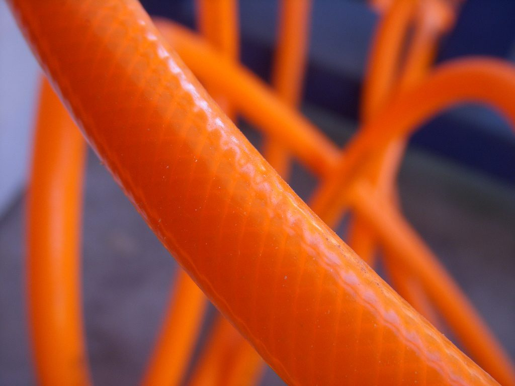 closeup of orange air hose