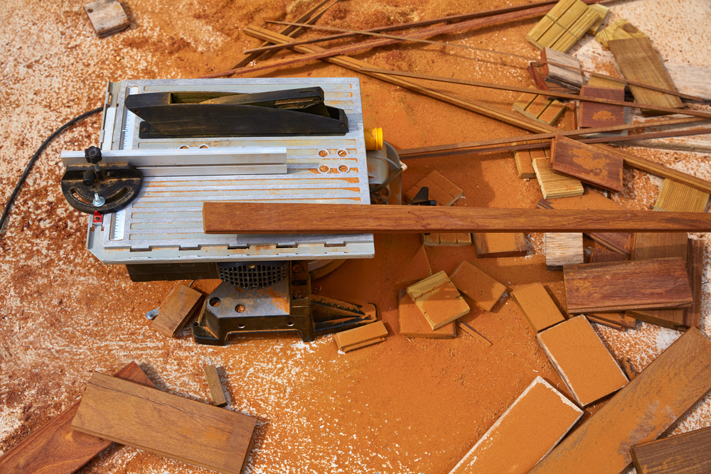 image of a benchtop table saw sitting on the floor