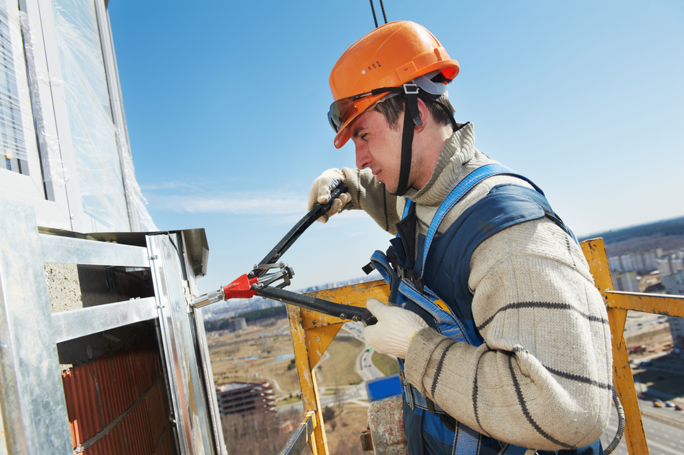 Worker builders at facade tile installation