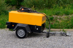 a yellow portable air compressor trailer