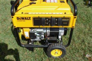 image of yellow dewalt generator on grass