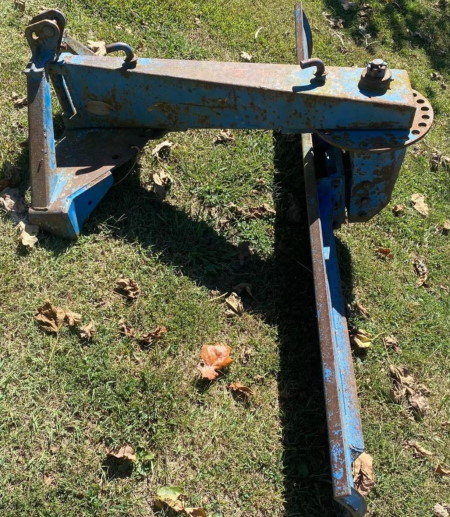 image of blue tractor rear blade