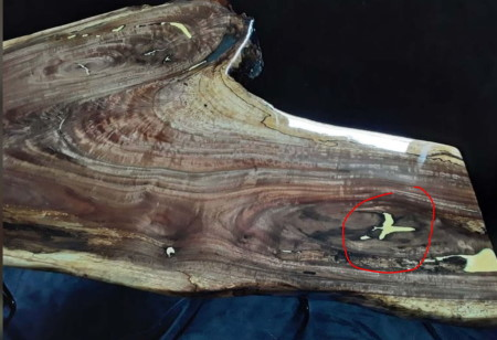 image of wood filler used on table with red circle